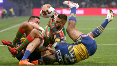 Rabbitohs fullback Corey Allan gets hauled down by the Eels defence in their semi-final.