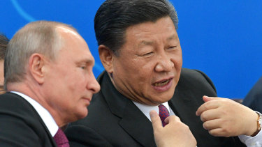 Russian President Vladimir Putin, left, and Chinese President Xi Jinping on Friday.