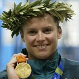 Newbery holds her gold medal after the women's 10m platform final at the Athens 2004 Olympic Games.