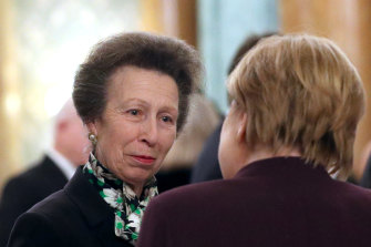 Princess Anne talks to German Chancellor  Angela Merkel at a reception for NATO leaders hosted by the Queen at Buckingham Palace on Tuesday night.