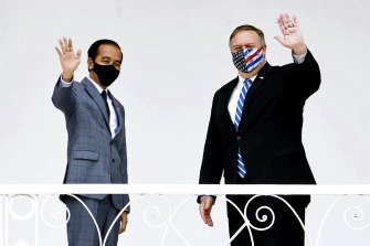 Indonesian President Joko Widodo, left, and US Secretary of State Mike Pompeo wave at the Presidential Palace in Bogor, West Java, on Thursday.
