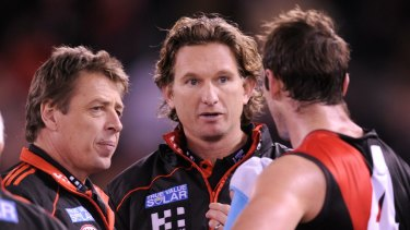 Mark Thompson with James Hird and Jobe Watson in 2012.