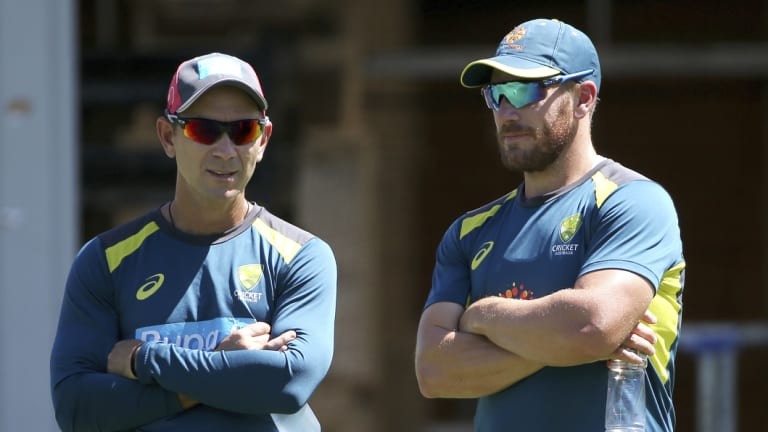 Easy call: Aaron Finch (right) with Australian coach Justin Langer last week.