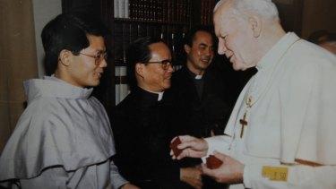 Bishop Long meeting Pope John Paul II in 1992.
