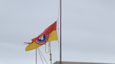 Both the local surf life saving club and the police station had flags flying at half-mast on Monday.