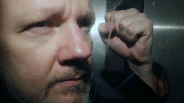 WikiLeaks founder Julian Assange being taken from court.