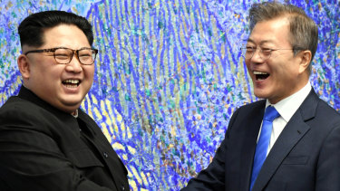 Kim Jong Un, North Korea's leader, shakes hands with Moon Jae-in, South Korea's president,  in the Demilitarized Zone on Friday.
