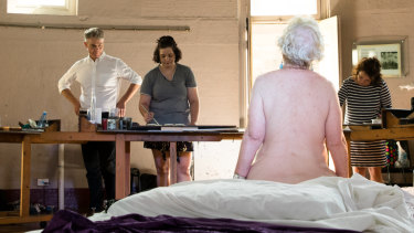 Steven Alderton, director of the National Art School with a life drawing class.