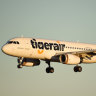 Tigerair plane turned around mid flight following threat