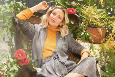 Kate Hudson wears clothing by her new brand Happy x Nature.