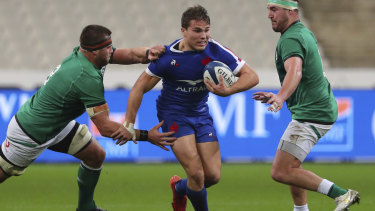 France's Antoine Dupont, centre is tackled by Ireland's CJ Stander, left, during the Six Nations rugby union international match between France and Ireland in Paris, France, Saturday, Oct. 31, 2020.