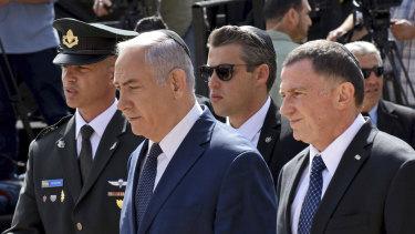 Israeli Prime Minister Benjamin Netanyahu, centre, and Knesset Speaker Yuli Edelstein, right.