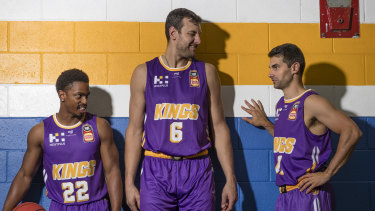 Kings star Kevin Lisch (right) with Casper Ware (left) Andrew Bogut.