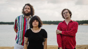 """American rock band Screaming Females: (l-r) Mike """"King Mike"""" Abbate (bass), Marissa Paternoster (guitar, vocals), Jarrett Dougherty (drums)."""