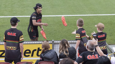 Jarome Luai pleases some fans by throwing them his boots.