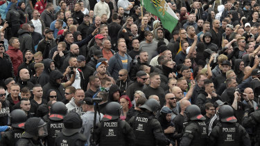 Men shout during a far-right protest in Chemnitz.