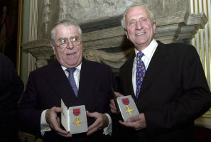 Albert, left and Michel Roux display their honourary OBE medals presented to them by the British Foreign Secretary Jack Straw, on behalf of Britain's Queen Elizabeth, at a ceremony at the Foriegn and Commonwealth offices in central London, 2002.
