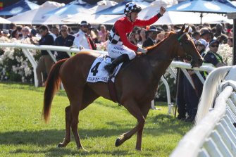 Trap For Fools ridden by jockey John Allen returns to the mounting yard after winning the Mackinnon Stakes.