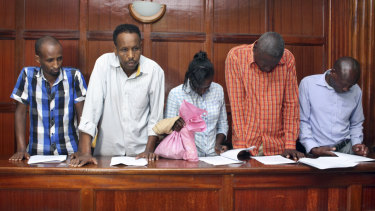 From left to right, suspects Osman Ibrahim, Guleid Abdihakim, Gladys Kaari Justus, Oliver Kanyango Muthee and Joel Nganga Wainaina appear at a hearing at Milimani law courts in Nairobi on Friday.