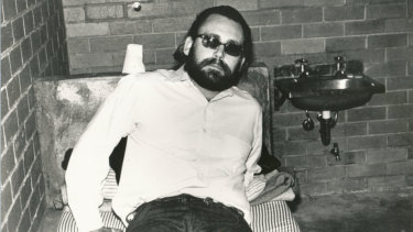 """James Patton Brandes, aka """"Sleepy Jim"""" or """"Jim-Jim"""", was sent from the US to Australia by the Hell's Angels to kill policeman Bob Armstrong. Seen here after being detained at the airport in August 1982."""