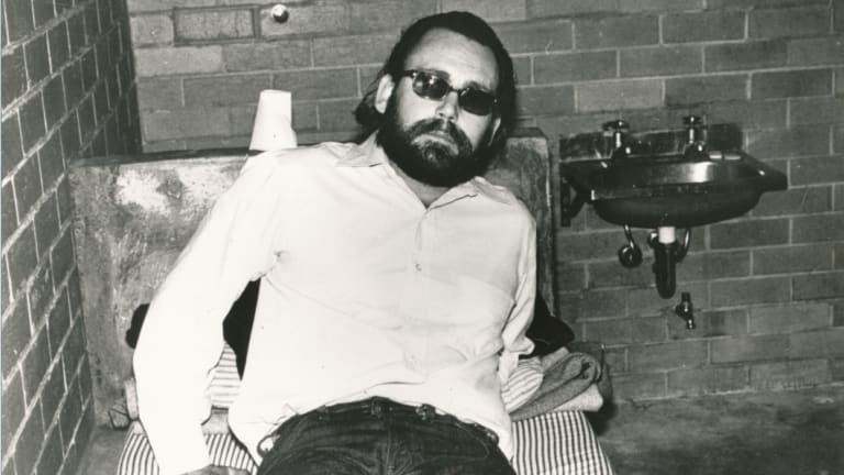 "James Patton Brandes, aka ""Sleepy Jim"" or ""Jim-Jim"", was sent from the US to Australia by the Hell's Angels to kill policeman Bob Armstrong. Seen here after being detained at the airport in August 1982."