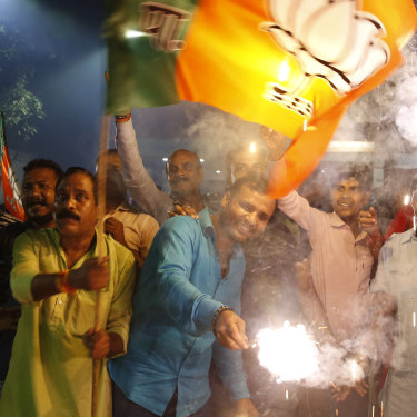 Supporters of India's ruling Bharatiya Janata Party in Lucknow celebrate the revoking of Kashmir's special status.