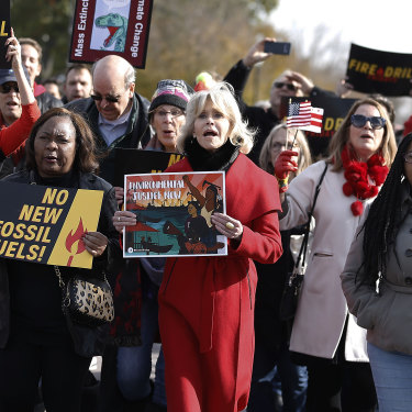 Demonstrating at a Fire Drill Fridays event in 2019. Fonda says the stand-out red coat will be the last new item of clothing she will buy.