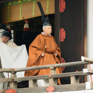 Akihito, right, leaves after a ritual to report his abdication at the Imperial Palace in Tokyo on April 30.
