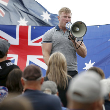 Right-wing figure Blair Cottrell addresses a rally in St Kilda.