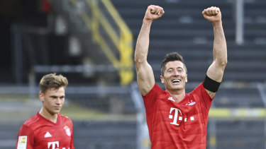 Kimmich, left, looks on as Bayern teammate Robert Lewandowski celebrates a goal likely to prove crucial in the Bundesliga title race.