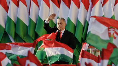 Hungarian Prime Minister Viktor Orban wraps himself in the flag on his way to three successive terms.