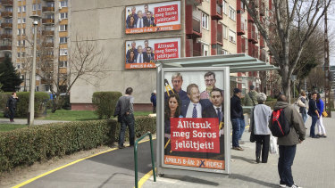 """Billboards from Prime Minister Viktor Orban's Fidesz party reads """"Together they would dismantle the border seal."""" showing American financier George Soros, center, with opposition leaders, in Budapest."""