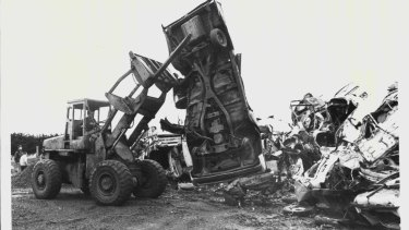 A photo from 1984, when a loader and compactor moved in on the derelict cars that have been home to eastern barred bandicoots at the Hamilton tip.