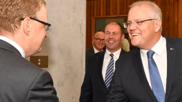Prime Minister Scott Morrison and Treasurer Josh Frydenberg meet RBA governor Philip Lowe at the Reserve Bank on May 22.