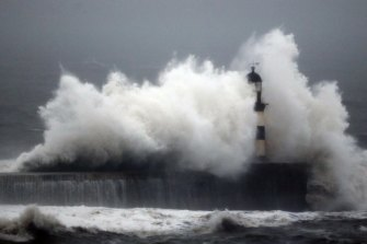 Waves engulf the Seaham Lighthouse in Durham, England, in early 2016. Sea-level rises may be a lot more than currently predicted by climate models because they largely exclude ice sheet contribution.