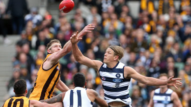 Tap off: Rhys Stanley (right) contests the ruck against Ben McEvoy during Geelong's round 18 loss to Hawthorn.