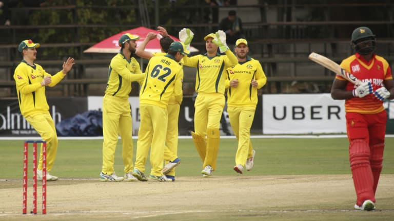 Long walk: Australia celebrate the wicket of Zimbabwean batsman Hamilton Masakadza.