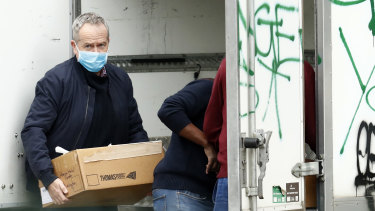 Labor MP Bill Shorten delivers food to the Flemington Towers Government Housing complex.