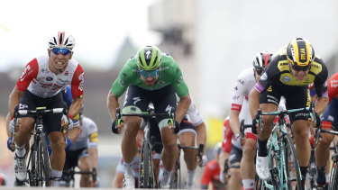 Three's a crowd: Caleb Ewan, left,   Peter Sagan, center, and  stage winner  Dylan Groenewegen fight out the finish of stage seven.