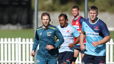 Referee Angus Gardner with Waratahs players as they train at David Phillips Sports Field on Friday.