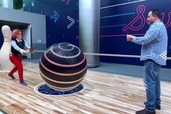 Playing a weird competitive bowling game that showed off Apple's latest AR tech.