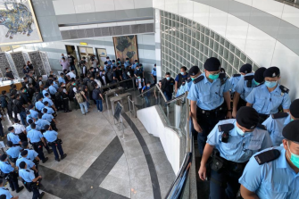 Hong Kong police raid the Apple Daily headquarters on Monday.