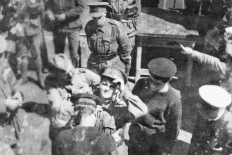 Maud Butler being fitted with a life belt before being transferred at sea from HMATSuevicto the Blue Funnel liner Achilles on December 24, 1915.