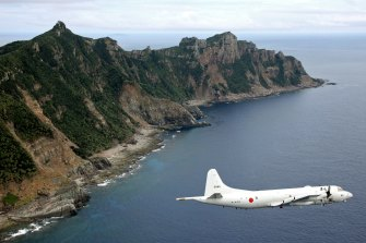 A Japan surveillance plane flies over the disputed islands, called the Senkaku in Japan and Diaoyu in China, in the East China Sea.