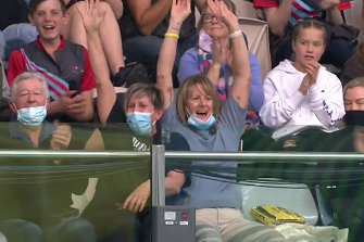Sharon McKeown reacts to Kaylee's world record in the stands in Adelaide.
