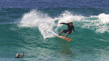 Luke Kennedy has a surf at Bondi.