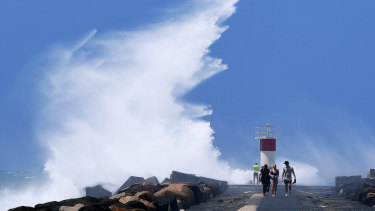A severe weather warning for damaging winds, abnormally high tides and dangerous surf remains for parts of the coast.