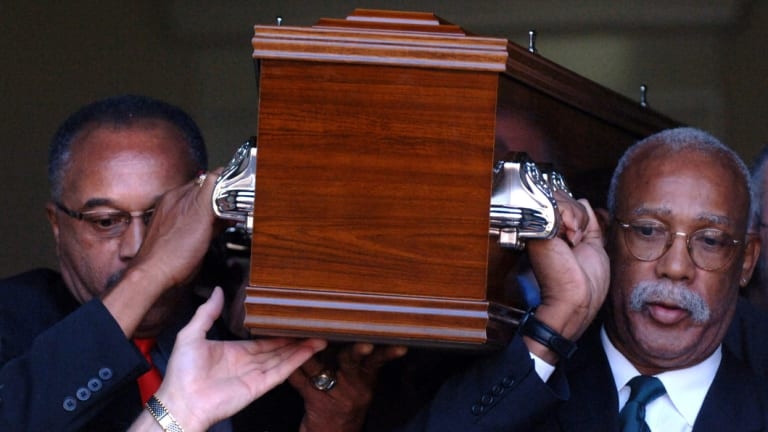 Respect: Tommie Smith (left) and John Carlos carry the coffin of Peter Norman from Williamstown Town Hall in Melbourne in 2006.