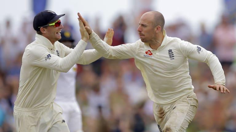 Skittled: Jack Leach celebrates the dismissal of Sri Lanka's Kusal Mendis.