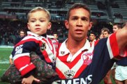 Boy, you've come a long way: Lachlan Lam joins his famous dad on the field for Adrian's last home game for the Roosters in 2000.